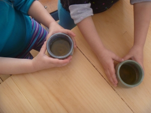 Tiny little pots of tea for each child.