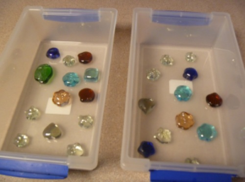 Sea glass shapes in a box.