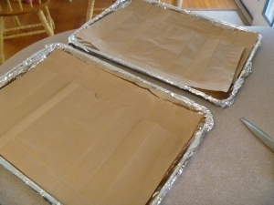 Baking sheets lined with aluminum foil and brown paper.
