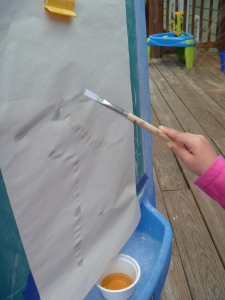 Use paint brush to apply tea to paper