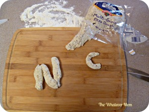 Pick up premade bread dough or pizza dough to create letter shapes