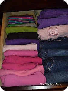 Fold pants one extra fold, stack and lie down in drawer.