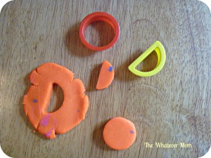 Cut out letters from play dough