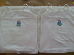 Twin tanks with subtle embellishments.