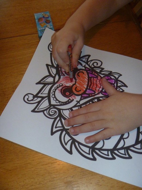 Coloring our dragon masks.