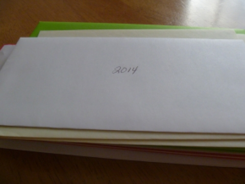 Write the date and holiday on the envelop.