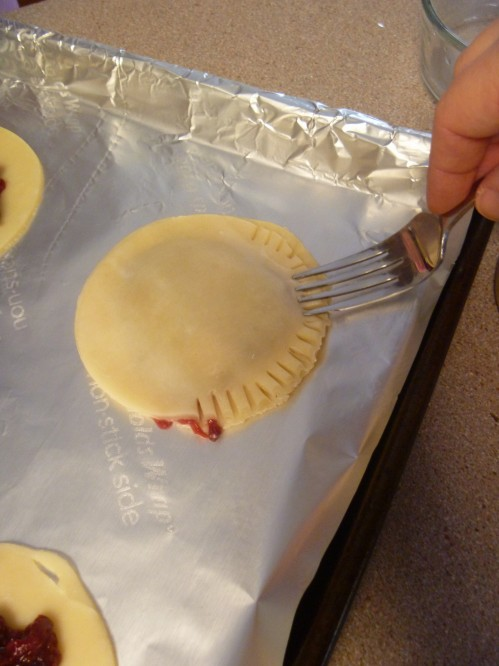 Use a fork, or pinch the edges to make a seal with the dough.