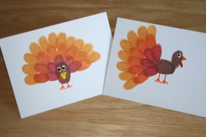 http://thecharmedmom.com/2010/11/thanksgiving-craft-fingerprint-turkey-cards.html